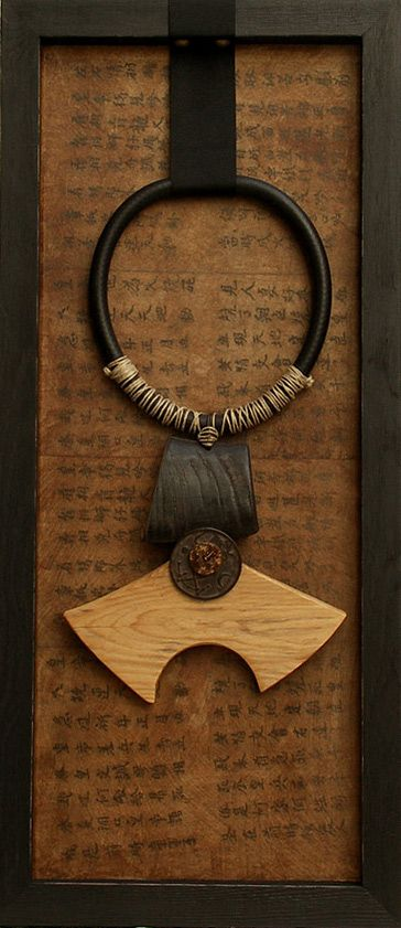 "AMALTHEE CREATIONS ""recycled wood and buffalo horn, ancient Chinese currency, sold in its frame (wood, paper, ink)"""