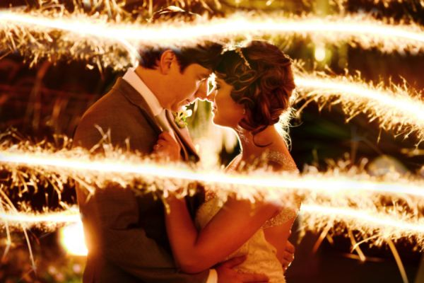 Love this bride and groom with the sparklers surrounding them as they dance! Photo by Captivating Weddings.