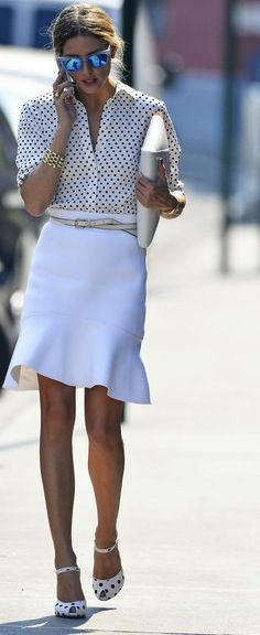 Polka dot blouse with white skirt, tan waist belt and matching leather clutch
