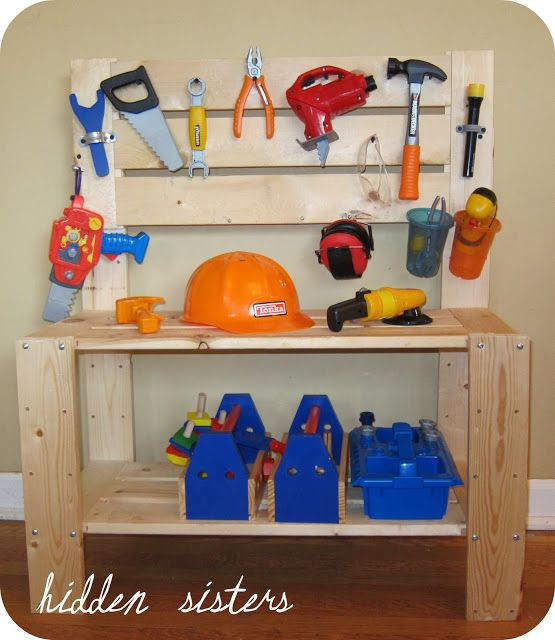 tool bench and real set of small tools for the boys, with nails and woodscraps, and belts safety goggles