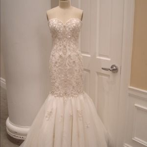 I just added this to my closet on Poshmark: Kleinfelds Wedding Dress- Sophia Moncelli. Price: $1500 Size: 10