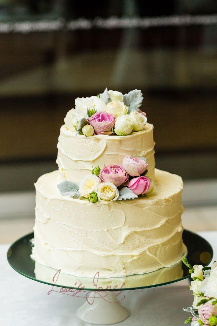 Flourless chocolate cake with a white chocolate ganache. Flowers by Georgie Stanton. Photo Credit: Louisa Jones Photography