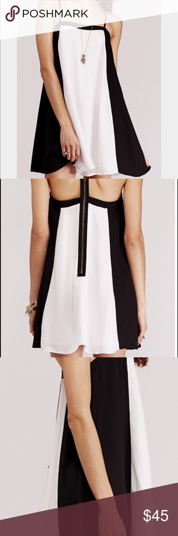 Ladakh Dress Size M The liquid dress from Ladakh will take you from a casual lunch to the races. Featuring black and white detail with t bar back and gold zip, the dress is floaty and A line style, so very flattering on the tummy, hips and bottom. The dress has adjustable spaghetti straps, is fully lined and with the black side panels, creates a slimming silhouette. This dress is an ideal choice for a casual weekend look with flats to a fascinator and earrings for the races or a special…
