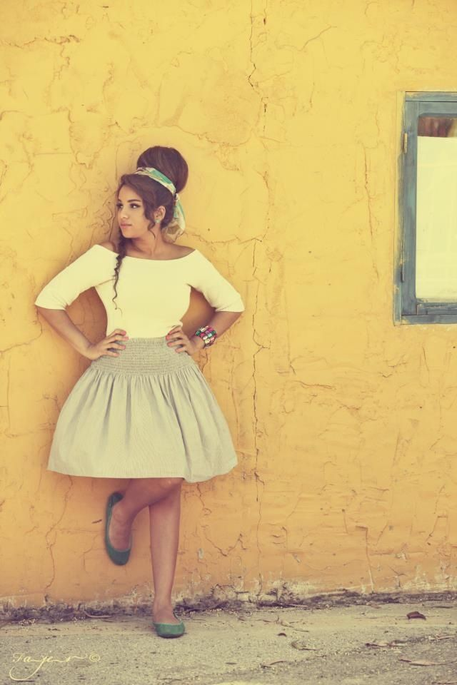 Like this one. Big hair against the colored wall