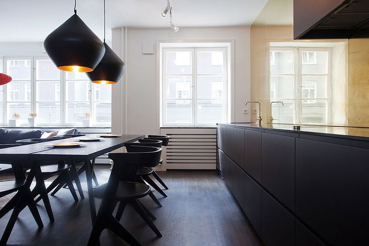 A Surprising Simply Black Kitchen Cabinet With Black Wooden Dining Table Along With Amusing Black Pendant Lamps With White Window Plus Venetian Blind Decoration A Small Cozy Apartment with Swedish New York Feeling Home design, Interior Design http://seekayem.com