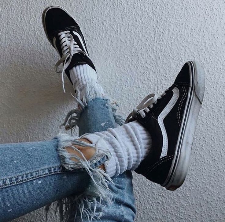 Classic combination for that perfect street style look. Vans skate shoe mixed with a frayed denim jean. Love it.