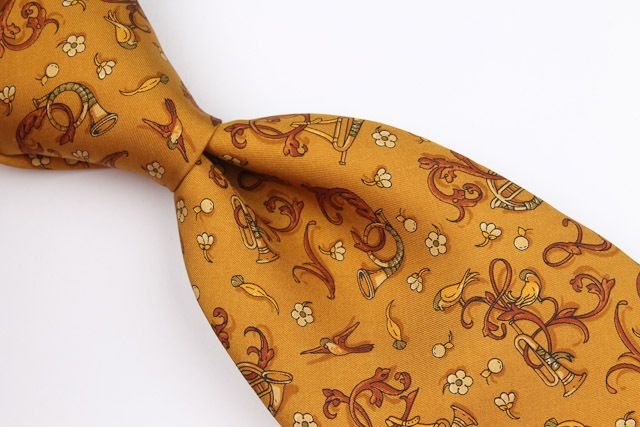 Salvatore Ferragamo Rustic Gold Whimsical Horn Pattern