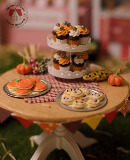 Miniature fall table with cookies and cupcakes
