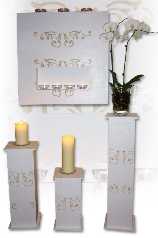 Kominek- dekoracja ściany z myślą o małej przestrzeni do tego kolumny, które można przestawiać i dekorować.