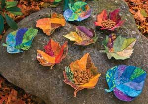 "Fabric bowls for treats or notions.  Cover an extra-stiff, heat-moldable stabilizer with fabric, and form into bowl shapes.  Pattern has Kristine Poor's directions for three 8""-9"" leaf designs."