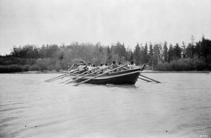 York boat on Nelson River, upstream from Churchill, Manitoba, Canada. 1913. Rowers manning the oars... Negative film cellulose nitrate.