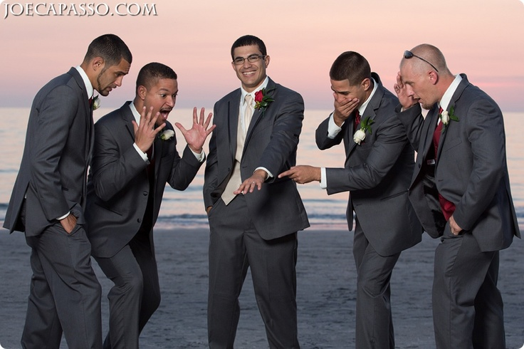 groomsmen looking at the ring!  http://joecapasso.com  wedding photography  Joe Capasso photographs weddings in Naples, Miami, Tampa, and Philadelphia PA!