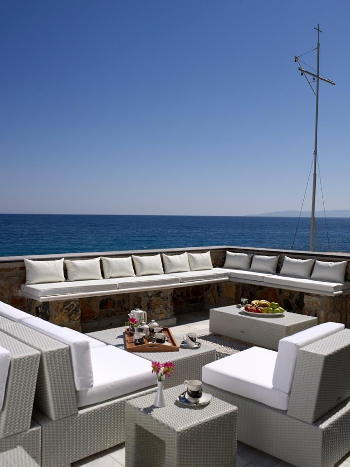 www.limedeco.gr a big living room with a sea view
