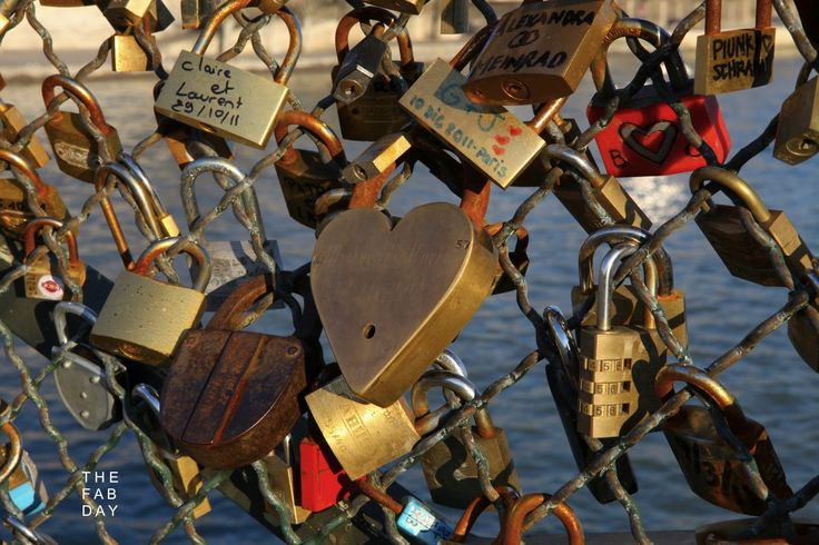 """Paris, France. Couples write their names on """"love locks"""" and locks them onto a bridge, then the key is thrown into the Seine River. This symbolizes undying love. I want to do this so bad"""