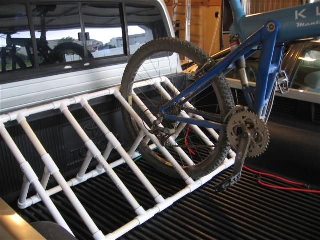 bike rack idea - pvc piping, to keep all the bikes neat at camp