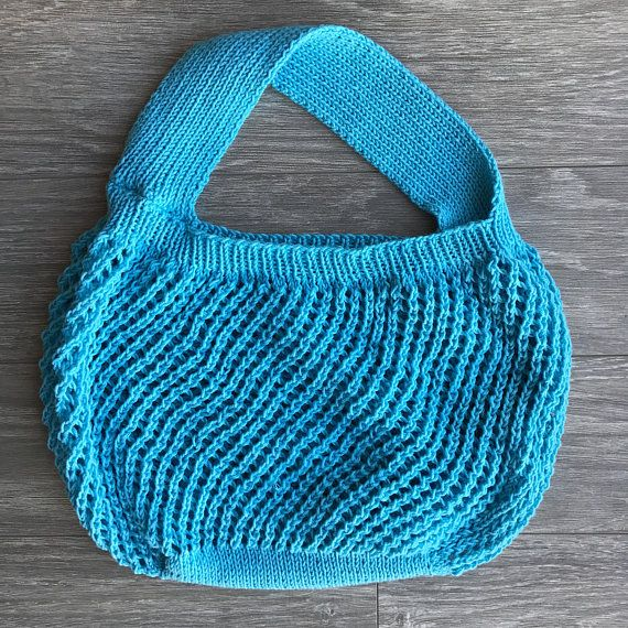 R E A D Y T O S H I P  This hand knit market bag is a washable and reusable bag making it the perfect way to haul groceries home from the supermarket or fresh flowers and veggies from the local farmers market.  Not only will you look great using the bag, but you will help the environment by cutting back on plastic bags you use with this reusable shopping bag. Consider it an eco-bag. Knit with a cotton mesh pattern, this bag is stretchy/expandable and easily stored in a purse or in the ca...