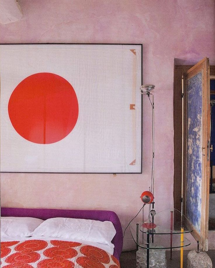 Roberto Baiocchi interior featuring Toio floor lamp by Achille Castiglioni