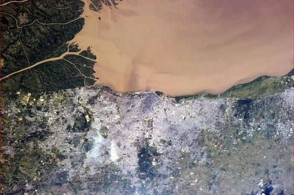 Tonight's Finale: Buenos Aires, Argentina - the Rio de La Plata visibly filled with silt from upstream.