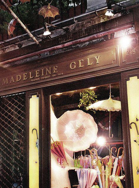MADELEINE GELY ~ The oldest, foremost umbrella shop (parapluie) in Paris. Boulevard Saint Germain.