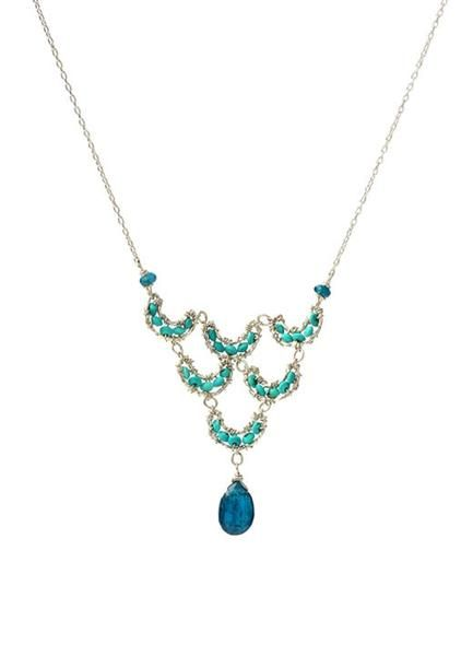 Striking blue Apatite is paired with Turquoise beads on this delicate style from Artist Michelle Pressler. Tiny gemstonesare hand wrapped with silver wire to c