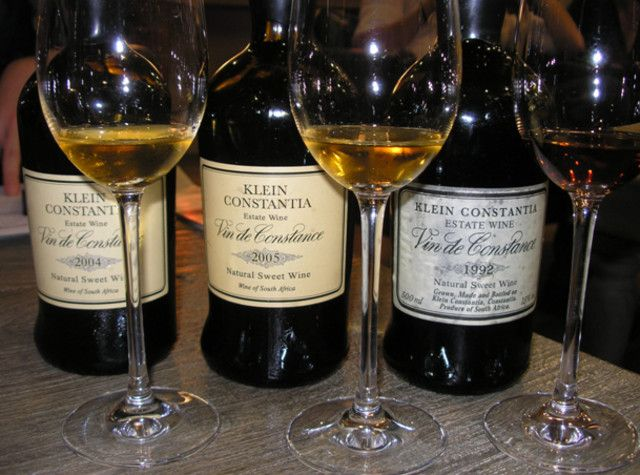 Three vintages of Klein Constantia winery's sweet Vin de Constance are lined up for tasting at Buitenverwachting restaurant in Constantia, Cape Town South Africa.