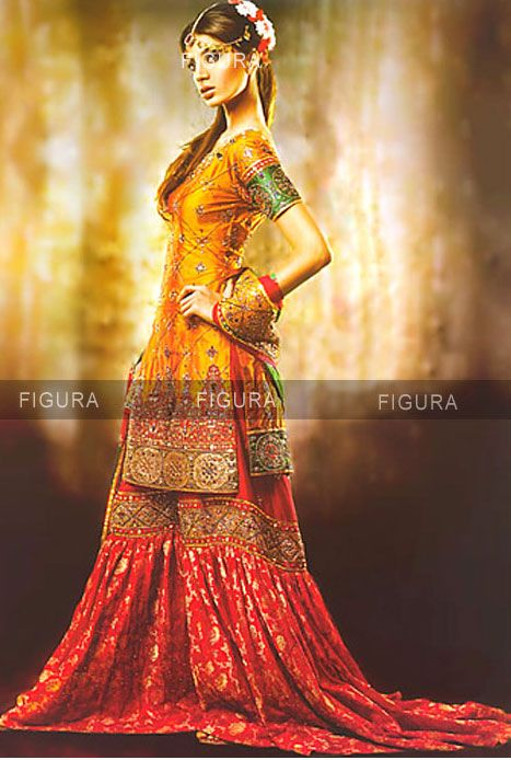 Silk bridal gharara in golden yellow and red.  Link: http://figurafashion.com/index.php?main_page=product_info&cPath=11