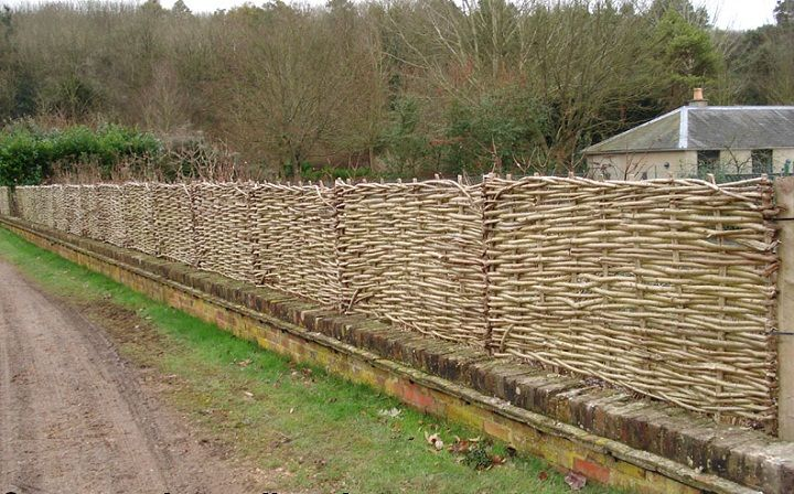 Wattle hurdles on top of brick wall. Stevens The Hurdle Maker offers Wattle Hurdles, Continuous Weave, Stakes and Binders, River Faggots, Ro...