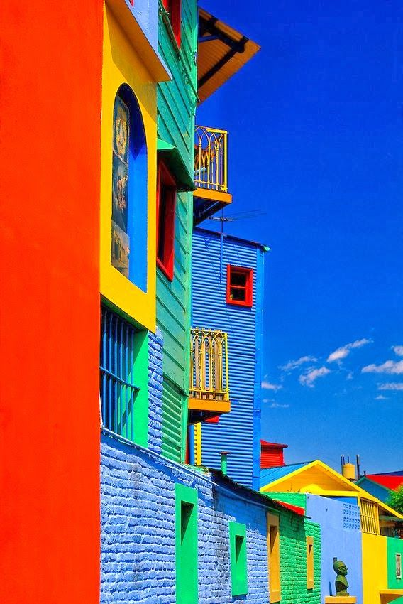 "Colors of Caminito in La Boca - Buenos Aires, Argentina. Caminito meaning ""little path"", a street museum of artists, musicians, shops and Latin cafes. In 1954 the street was brightly painted to enhance the neighborhood ""eyesore"" and a stage put in at one end and it became what it is today. It acquired cultural significance after inspiring the music for the Tango Caminito."
