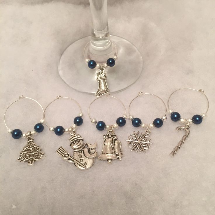 A personal favourite from my Etsy shop https://www.etsy.com/uk/listing/255872338/christmas-wine-glass-charms-hostess-gift