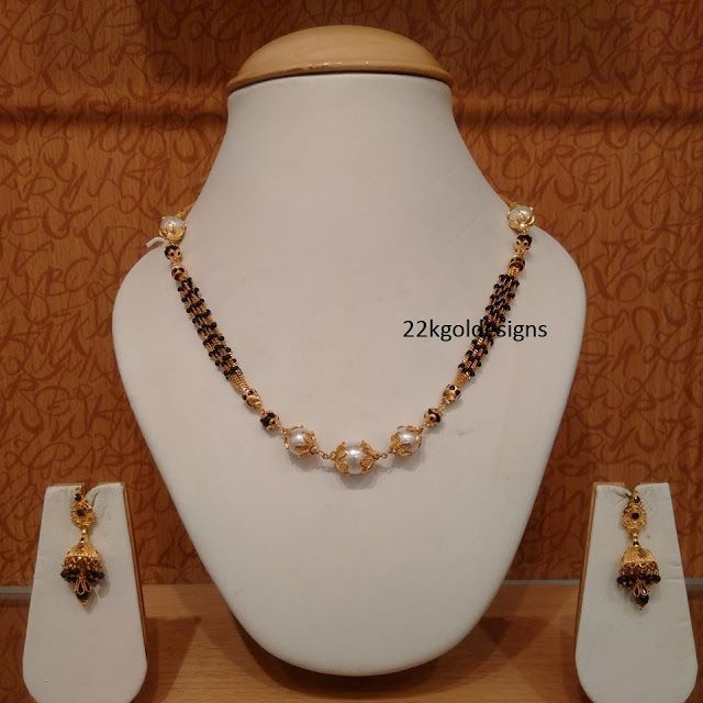 Latest Indian Gold and Diamond Jewellery Designs: Black beads South sea pearl Mala