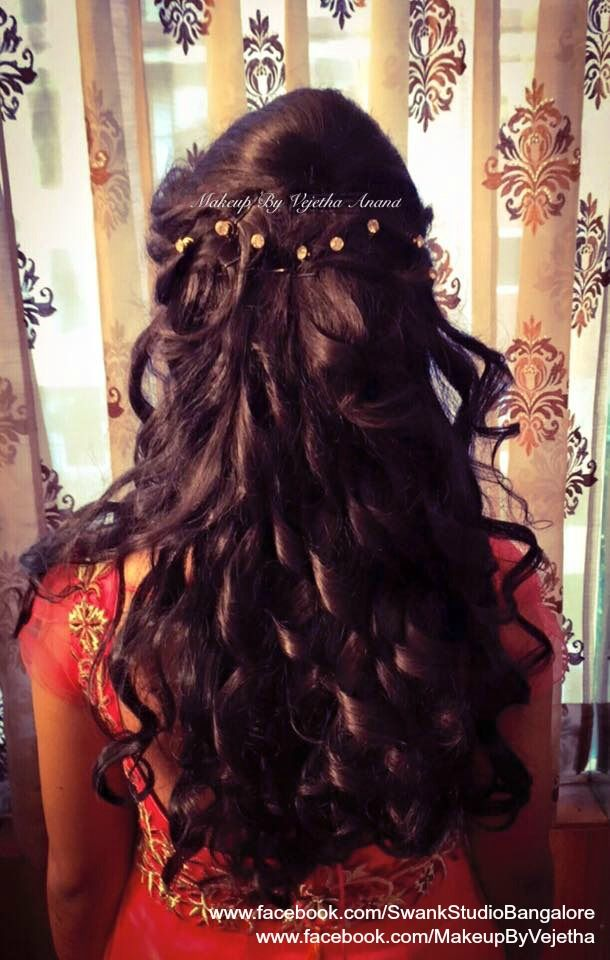 Indian bride's reception hairstyle by Vejetha for Swank Studio. Curls. Bridal gown. Hair Accessories. Tamil bride. Telugu bride. Kannada bride. Hindu bride. Malayalee bride. Find us at https://www.facebook.com/SwankStudioBangalore