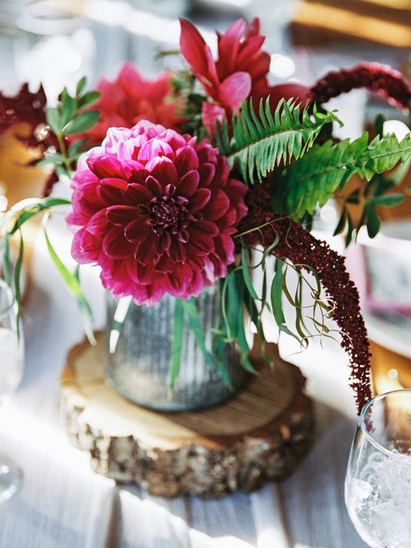 burgundy dahlia centerpiece - photo by Justin Tearney http://ruffledblog.com/collaborative-pennsylvania-farm-wedding