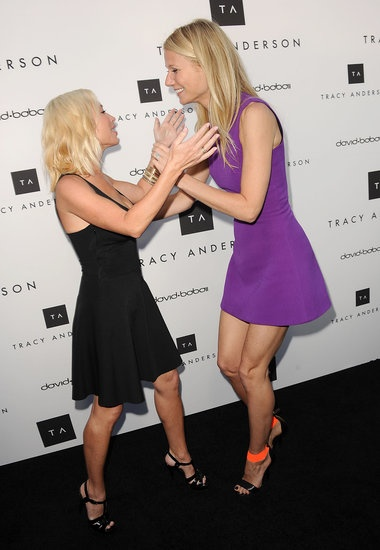Gwyneth Paltrow and Tracy Anderson played around on the carpet together at Tracy's studio opening. Click for more!