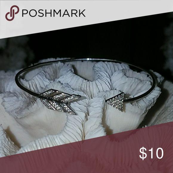 Silver Arrow bracelet Silver Arrow bangle bracelet has a minor kink on the back side but is in good condition Jewelry Bracelets
