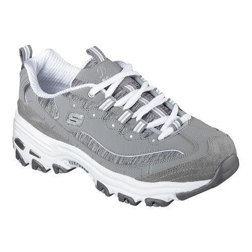"""A classic look gets updated with comfort in the SKECHERS D'Lites Sneaker. Lace up sporty casual sneaker with stitching and overlay accents. Memory Foam insole. Heel Height: 0"""" Fit: True to Size Specia"""