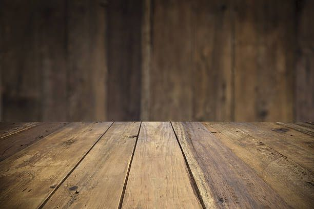 empty wood table with defocused vertical table background