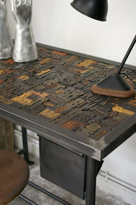 Wood type table: ducotedudesign. Very pretty, great surface when you think of a 'writing' desk -- has this table top been printed? Also a bit of a waste. I know several printers who are always looking for working printable wood specimens.