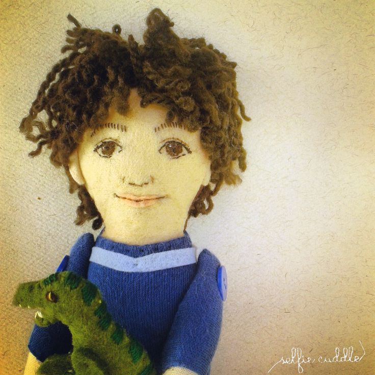 fabric handmade doll, portrait, small boy, selfie doll, face detail, embroidery