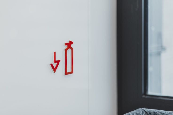 Maybe we develop an icon set to replace the less than ideal signs for fire extinguishers and such.