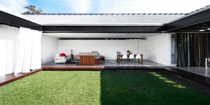 house opens into central courtyard