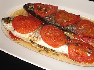This method of cooking sea bass (Lavraki) is popular on the island of Cephalonia, especially in Fiskardo, where large amounts of the fish can be found in the sea. What makes it different is that the stomach is filled with the garlic an herbs and it is baked wrapped in greaseproof paper.