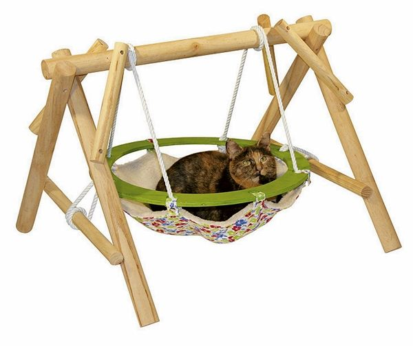 The gentle swinging of this #hammock offers a sweet relaxation for your cat.  Take a look at 10 pet hammock ideas at: http://impressivemagazine.com/2013/07/23/10-pet-hammock-ideas/#more-12217
