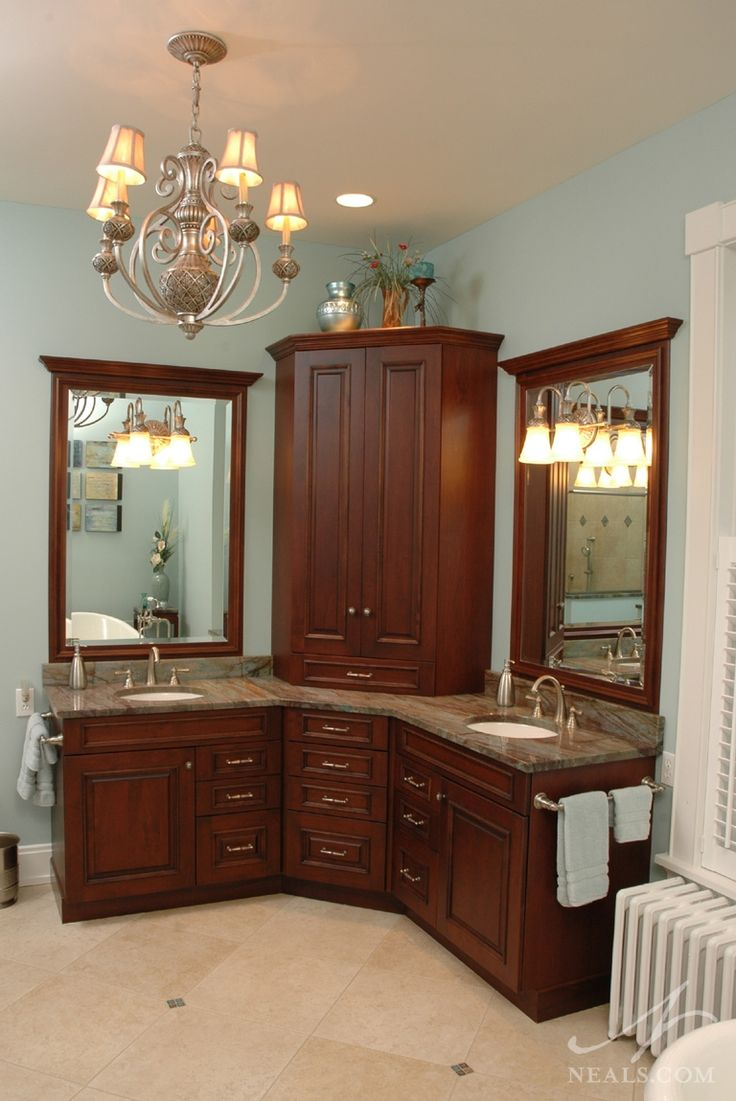 Don't care for the cabinetry but this is the design that I have to figure out for our new master bath… this type will work. corner double sink vanity