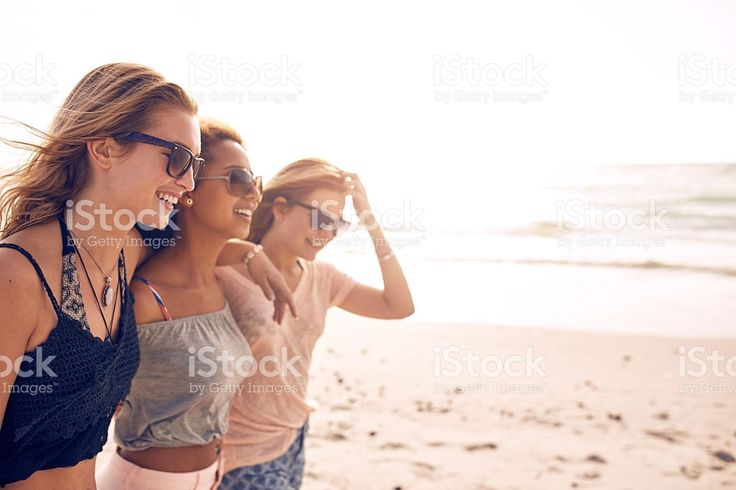 Happy young women walking on a beach royalty-free stock photo