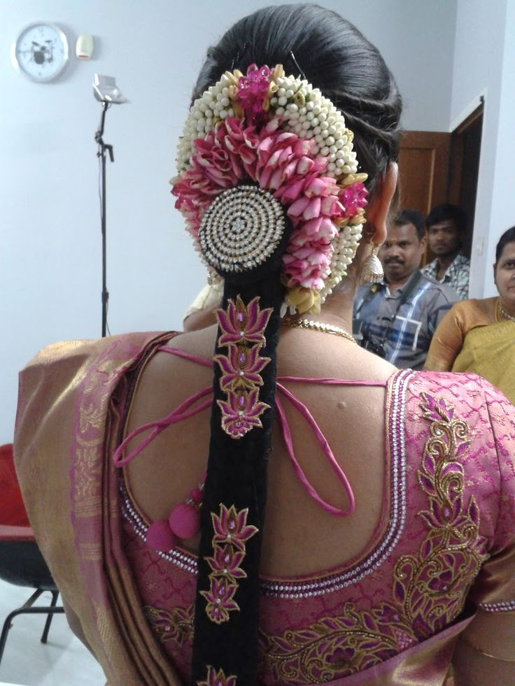 Traditional bridal hairstyle sported by a Southern Indian bride