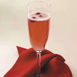 Poinsettia    ingredients  1 ounce cranberry juice  1/2 ounce Triple Sec, optional  4 ounces chilled Champagne or other sparkling wine  GARNISH:  3 fresh cranberries