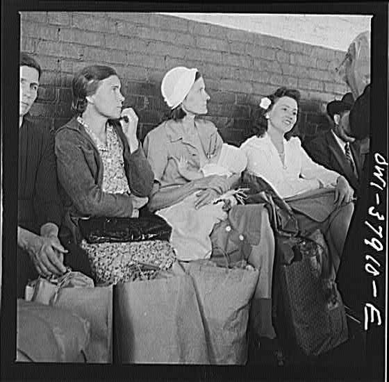25 Historical Images That Normalize Breastfeeding A Mother Feeding Her Baby at a Chattanooga Bus Stop - 1943