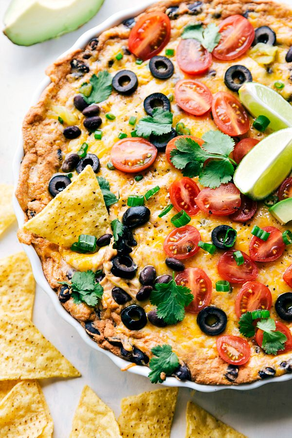 Loaded Texas Trash dip is the classic warm bean dip that gets loaded with corn, olives, black beans, and ooey gooey cheese! This dip will be the hit at your next party! I don't know about you guys but I am loving football season.  Not just getting together with friends to watch a football …
