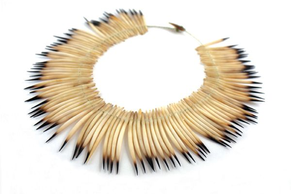 Jeannette James, necklace : Echidna quills  ( Jeanette James is a Tasmanian aboriginal artist who grew up with her mother, Aboriginal artist Corrie Fullard, in northern Tasmania. She spent her early years walking the beaches of the island collecting shells )