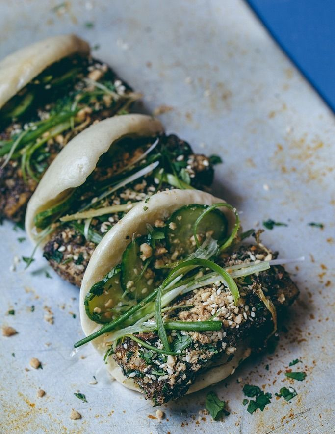 This Salt and Pepper Tofu Gua Bao recipe is seasoned to perfection featuring a yummy pickled cucumber salad in between the bao bun. More please!